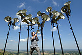 Composer and director of The Shout choir Orlando Gough with megaphones on Devils Dyke,  Sussex ALMAF45P8| 写真素材・ストックフォト・画像・イラスト素材|アマナイメージズ