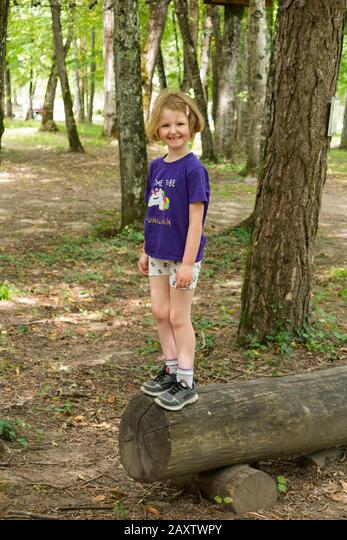 Young girl girls child kid on a children obstacle course activity Trail in woodland forest tree, at an adventure park in France during the summer. (112) ALM2AXTWPY  写真素材・ストックフォト・画像・イラスト素材 アマナイメージズ