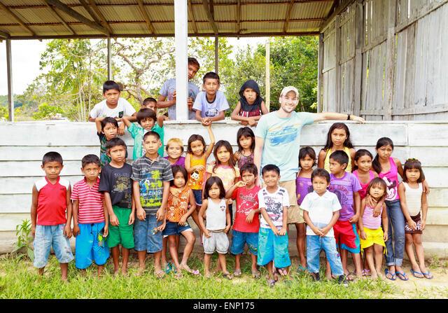 School children in a remote Brazilian Satere village pose with an American missionary visitor ALMENP175  写真素材・ストックフォト・画像・イラスト素材 アマナイメージズ