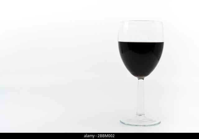Glass of red wine on a plain white background with space for copy ALM2BBM002| 写真素材・ストックフォト・画像・イラスト素材|アマナイメージズ